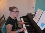 "Izzy working on current song ""Mama Mia by Abba"""