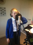 "Emily recording vocals for one her own songs she wrote ""Best Friends"""